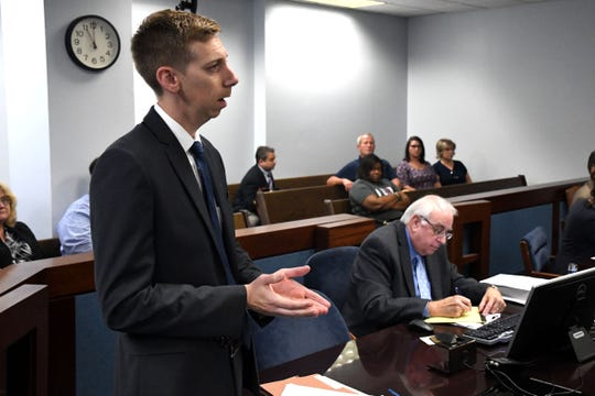 Thomas Williams, assistant state attorney for the 1st Judicial Circuit in Pensacola, speaks with the judge about the bail amount for former Jackson County deputy Zach Wester. Wester was arrested Wednesday for racketeering and other charges.