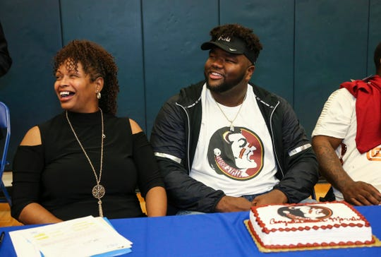 Feb 1, 2017; Houston, TX, USA; Marvin Wilson (right) and his mother after signing with the Florida State Seminoles at Episcopal High School. Mandatory Credit: Troy Taormina-USA TODAY Sports