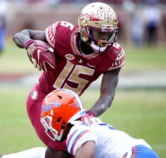 Nov 24, 2018; Tallahassee, FL, USA; Florida State Seminoles wide receiver Tamorrion Terry (15) picks up a first down against the Florida Gators during the second half of action at Doak Campbell Stadium. Mandatory Credit: Glenn Beil-USA TODAY Sports