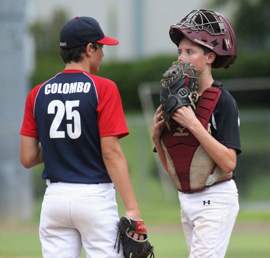 Catcher Gavin Rudd talks to pitcher Andrew Colombo as Tallahassee-Leon Babe Ruth's 13U all-star team practices at TCC prior to this week's state tournament.