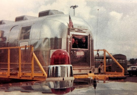 Apollo 11 astronauts can be seen peering through the window of an Airstream trailer at the crowds that gathered to welcome them back to U.S. soil for the first time after walking on the moon. The USS Hornet picked them up and brought them to Pearl Harbor just a couple of days after they walked on the moon in July of 1969.