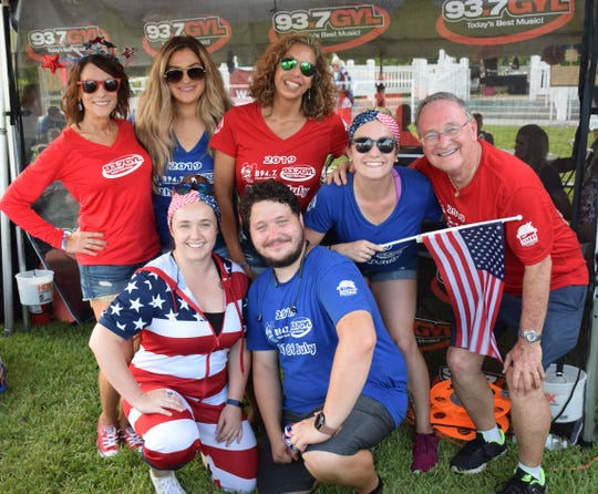 Enjoying the Vero Beach Fourth of July are, from left, back row, Karen Franke, Callie Schnur, Julie Lilliquist, Kayla Provost and Hamp Elliott, with Chelsea Rose, kneeling, and Alex Dietrich, representatives from Treasure & Space Coast Radio stations B 94.7, 93.7 GYL, 94.7 Fresh Country and 97.1 Ocean FM.