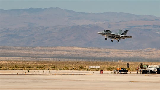 """An F/A-18 Hornet assigned to the """"Vampires"""" of Air Test and Evaluation Squadron 9 descends onto the runway at Naval Air Weapons Station China Lake on Wednesday as the squadron resumed operations in the wake of a pair of earthquakes. After the quakes, China Lake non-essential personnel were sent to Naval Base Ventura County."""