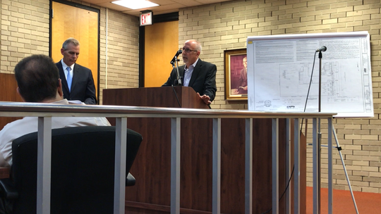 Professional planner Steve Hawk (podium) testifies Wednesday night to the Vineland Planning Board during a hearing for a proposed medical marijuana dispensary on North Delsea Drive. Attorney Clint Allen, representing Columbia Care, listens to his witness. The plan was approved.