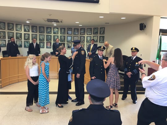 Thomas Dolan, left, and Blaine Howell get their bars pin after being promoted to lieutenant during a Ramapo police promotion ceremony in Town Hall on July 11, 2019