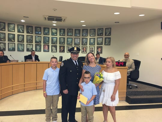 Ramapo Police Capt. Daniel Hyamn, his wife, Sgt. Margaret Sammorone, and their three children at Hyman's promoted during a Town Hall ceremony on July 11, 2019