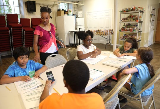 Vivian London-Crooks teaches financial literacy to a group of students during her 4-week summer class at the Berea 7th Day Adventist Church in Nyack July 11, 2019.  London is an accountant with 20 years of experience.