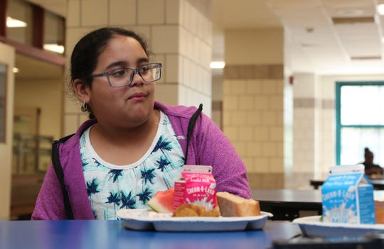 Khamila Pabon, 10, eats lunch at the Cesar E. Chavez School in Yonkers on Thursday, July 11, 2019, during the free summer breakfast and lunch program.