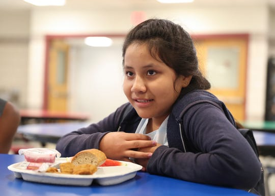 Ashley Luna, 11, eats lunch at the Cesar E. Chavez School in Yonkers on Thursday, July 11, 2019, during the free summer breakfast and lunch program.