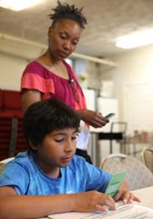 Frankie Porter, 11 reads a card during Vivian London-Crooks' 4-week financial literacy summer class at the Berea 7th Day Adventist Church in Nyack July 11, 2019.  London is an accountant with 20 years of experience holding a workshop to teach children about money.