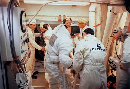 On the Apollo 11 launchpad, Pad leader Guenter Wendt talks with Neil Armstrong. ILC Industries is displayed prominently on Wendt's back.