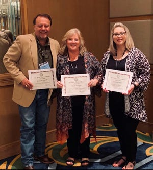 Wichita County Tax Collector Assessor Tommy Smyth, left, Chief Deputy Nicki Kingry and Assistant Motor Vehicle Supervisor Lauren Hart were recognized in a conference in Galveston for completion of the training prerequisites for the (C.T.O.P) Certified Tax Office Professional designations under Senate Bill 546. The Wichita County motor vehicle office is trying for a gold-level accreditation for quality business practices and customer service.