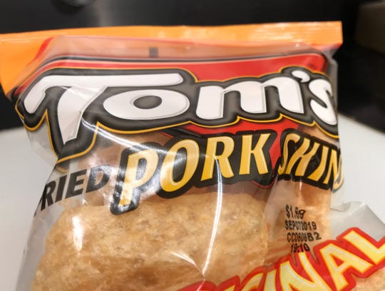 Man arrested for allegedly stealing a bag of pork rines.