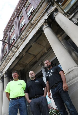 Jarrett Daniels, right, Wayne Newland, George Shreve and Dustin Daniels, not pictured, have purchased the Masonic Temple in downtown Zanesville