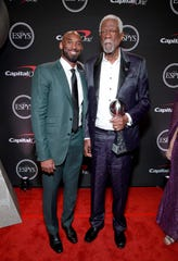Kobe Bryant, left, and Bill Russell, of the Arthur Ashe Courage Award, attend, The 2019 ESPYs at Microsoft Theater.