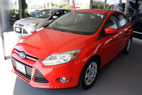 A Ford Focus is parked at a car dealership in San Jose, Calif. on Aug. 30, 2011.