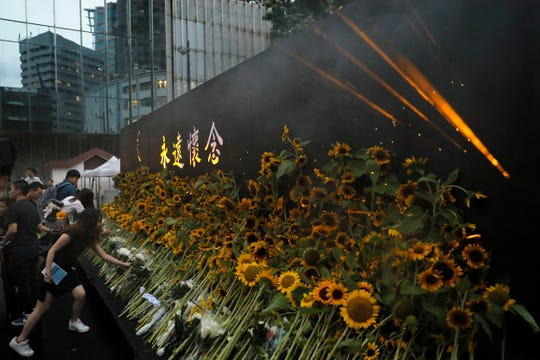 Attendees take part in a public memorial for Marco Leung, the 35-year-old man who fell to his death weeks ago after hanging a protest banner against an extradition bill, in Hong Kong, Thursday, July 11, 2019.