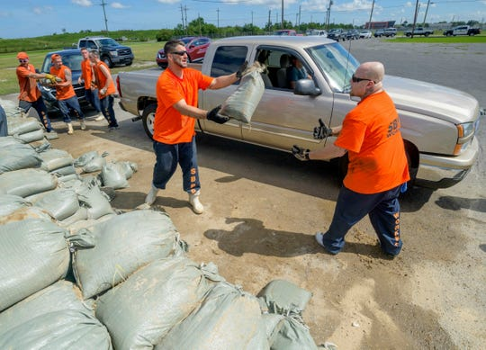 St. Bernard Parish Sheriff's Office inmate workers move free sandbags for residents in Chalmette, La., July 11, 2019 ahead of ahead of Tropical Storm Barry from the Gulf of Mexico.