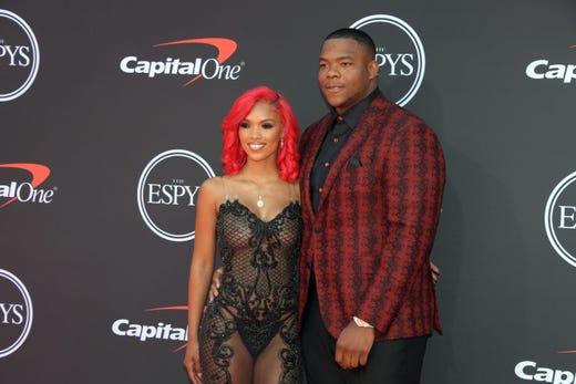 Yuanna Taylor and Daron Payne, Washington Redskins player.