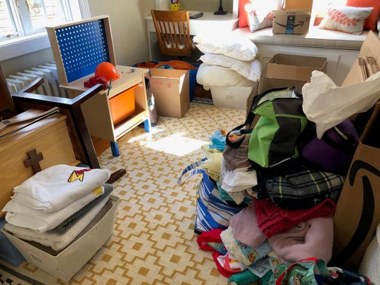 Their mother, Libby Newman, opted to rent a storage container during their moving process to help in the decluttering process.