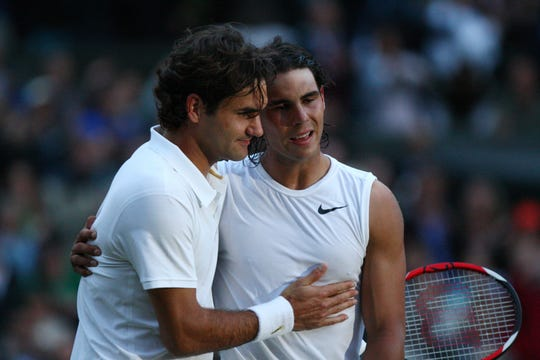 Roger Federer, left, congratulates Rafael Nadal after Nadal emerged victorious from their epic Wimbledon final match in 2008.