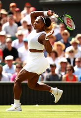 Serena Williams of the United States plays a forehand in her Ladies' Singles semi-final match against Barbora Strycova of The Czech Republic during Day Ten of The Championships - Wimbledon 2019 at All England Club in London.