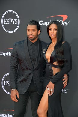 Russell Wilson, Seattle Seahawks player, and Ciara.
