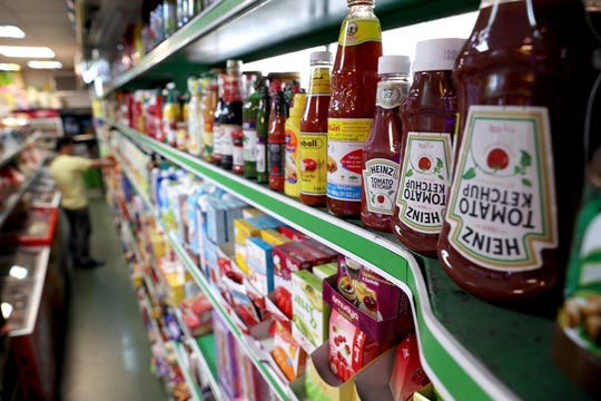 Heinz Ketchups are displayed in a grocery store in downtown Tehran, Iran, Wednesday, July 10, 2019.