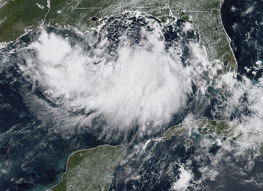 This satellite image obtained from NOAA/RAMMB, shows a tropical storm formed in the Gulf of Mexico, on July 11, 2019, at 15:40 UTC.
