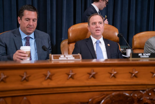 Rep. Devin Nunes, R-Calif, the ranking member on the House Intelligence Committee, left, and Chairman Adam Schiff, D-Calif., open a hearing on politically motivated fake videos and manipulated media, on Capitol Hill in Washington, Thursday, June 13, 2019.