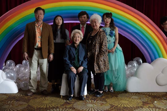 """Instead of telling their grandmother she is dying, Billi's (Awkwafina) family throws an impromptu wedding in China so they can get together in """"The Farewell."""" From left: Tzi Ma, Awkwafina, Zhao Shuzhen, Chan Han, Lu Hong and Aoi Mizuhara."""