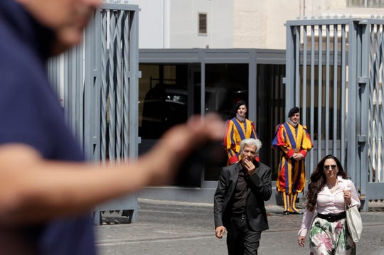 Pietro Orlandi, brother of Emanuela Orlandi who when missing in 1983, walks with his lawyer Laura Sgro after the Vatican reopened two tombs in the Teutonic Cemetery inside the Vatican, Thursday, July 11, 2019.