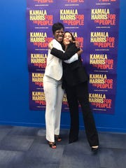 Kamala Harris hugs her line sister Lorri Saddler Rice at a fundraiser event.