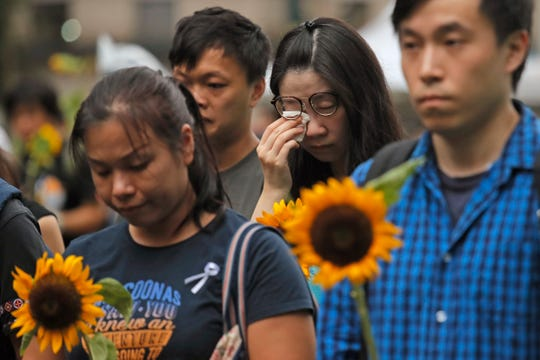 Attendees take part in a public memorial for Marco Leung, a 35-year-old man, who fell to his death weeks ago after hanging a protest banner against an extradition bill in Hong Kong, Thursday, July 11, 2019.