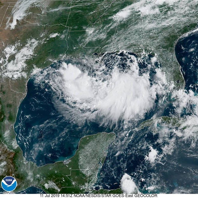 A satellite image shows Tropical Storm Barry spinning in the Gulf of Mexico on Thursday morning.