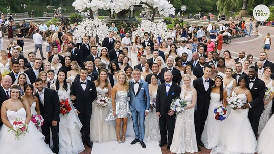 52 couples from every state say yes to the dress, and 'I do,' in mass Central Park wedding