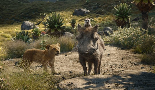 "Young Simba (voiced by JD McCrary, left) makes friends with meerkat Timon (Billy Eichner) and warthog Pumbaa (Seth Rogen) in ""The Lion King."""