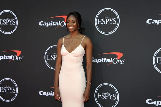Tami Alade, volleyball player.