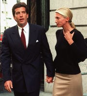 John F. Kennedy Jr. and his wife, Carolyn Bessette, leave their New York apartment Oct. 6, 1996, the day after returning from their honeymoon in Turkey.