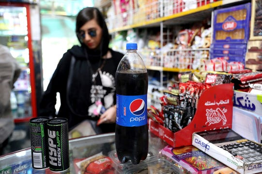 An Iranian Customer buys a Pepsi in a grocery store in downtown Tehran, Iran, Wednesday, July 10, 2019.