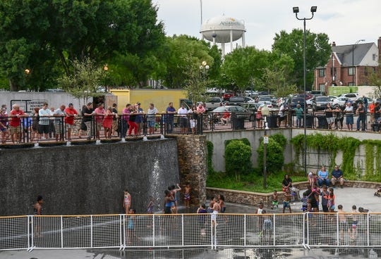 People stand above the waterfall listening to live music during Piedmont Natural Gas Block Party at Carolina Wren Park in July 2019. A smoking ban in downtown Anderson includes parks, starting November 1.