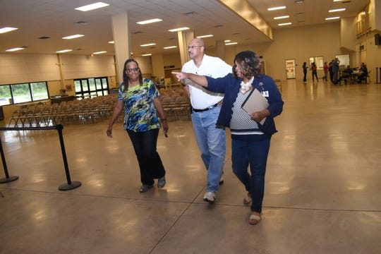 Felicia Calbert (far right), public affairs officer with the Department of Children and Family Services, gives La. State Rep. Ed Larvadain III for District 26 and his legislative aide LeCrete Robinson a tour of the Mega Shelter Friday, July 12, 2019. The shelter has not officially opened.
