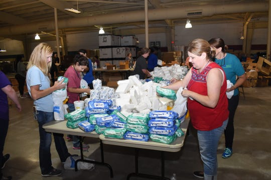 Volunteers prepare hygiene kits for shelter residents at the Mega Shelter located at 8125 Highway 71 next to LSU of Alexandria. The shelter will open once Gov. John Bel Edwards officially declares it to open.