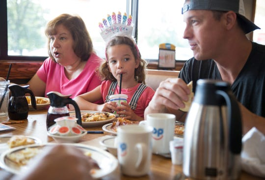 The Koontz family of  Ocean celebrate the 6th birthday of twins Liam and Olivia at the new IHOP restaurant in Wall. Left to right are Lynne Thomasey, Olivia Koontz, and Michael Koontz.   Wall Township, NJ Friday, July 12, 2019