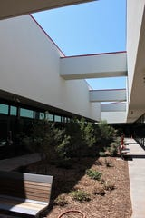 A courtyard was created at the former Kmart, separating the new Abilene Police Department, left, and Municipal Court. July 11 2019