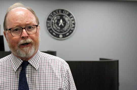 Judge Keith Barton, standing in front the witness stand in one of two new municipal courtrooms, said he was challenged to sort through 30 years of his things to move to the new location on South First Street. New equipment, he joked, did not include new robes. July 11, 2019