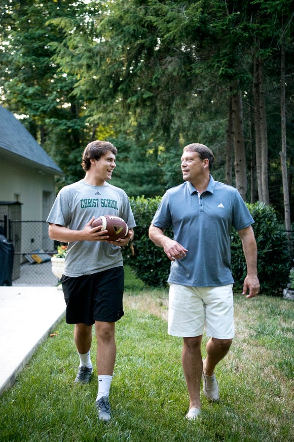 Christ School senior quarterback Navy Shuler and his dad, former NFL quarterback Heath Shuler, in the backyard of their home on July 2, 2019.