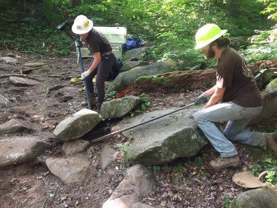 Members of the ACE crew remove stones from the Trillium Gap Trail in Great Smoky Mountains National Park.