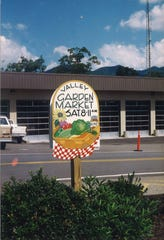 A hand-painted sign by Mary Soyenova marks the Valley Garden Market, which she launched with Renate Rikker in 1994. The Black Mountain Tailgate Market, as it's known today, will celebrate its 25th anniversary on July 20.