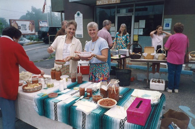 Mary Soyenova, left, and Renate Rikker serve salsa at the Valley Garden Market, which they founded in 1994. Now known as the Black Mountain Tailgate Market, the organization will celebrate 25 years on July 20.